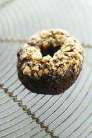 Mini Banana Chocolate Crunch Doughnut on a Cooling Rack