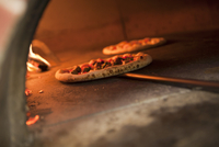 Pizza on Pizza Paddle in a Wood Burning Pizza Oven 22199075612| 写真素材・ストックフォト・画像・イラスト素材|アマナイメージズ