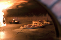 Pizzas in a Wood Burning Pizza Oven