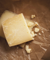 Wedges of Gruyere Cheese on Paper