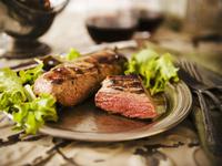 A Whole Tri-Tip Steak with Half a Tri-Tip Steak on a Plate 22199075647| 写真素材・ストックフォト・画像・イラスト素材|アマナイメージズ