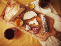 Salami, Cheese, Bread and Marmalade on a Wooden Board