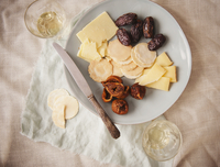 Cheddar Cheese with Crackers, Figs and Prunes on a Plate; Wi