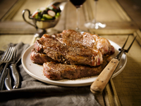 Platter of New York Strip Steaks with Serving Fork; Salad an 22199075658| 写真素材・ストックフォト・画像・イラスト素材|アマナイメージズ