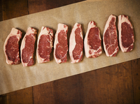 Raw Grass Fed New York Strip Steaks on Parchment Paper 22199075660| 写真素材・ストックフォト・画像・イラスト素材|アマナイメージズ