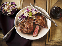 Grass Fed Rib-Eye Steak with Slaw and Red Wine; On a Plate;