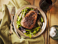 Grass Fed Sirloin Steak on a Bed of Greens; From Above; With