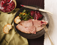 Plate with Slices of Baked Ham, Broccoli Rabe, Cranberry Sau