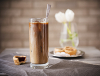 Tall Glass of Iced Coffee with Mini Tarts