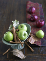 Granny Smith Apples with Cinnamon Sticks; Red Apples in Back