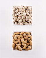 Two Bowls of Nuts; Pistachios and Cashews