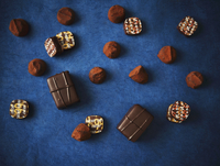 Assorted Chocolates on a Dark Blue Background