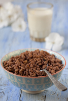 Chocolate rice crispies and a glass of milk