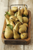 Organic pears on a wooden tray