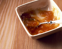 Peach and malt beer preserve in a dish with a spoon