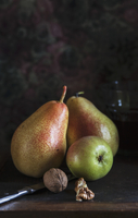 An autumnal arrangement with pears and walnuts
