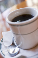 Black Coffee in a Diner Cup on a Saucer with Spoon