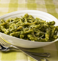 Serving Bowl of Pasta Tossed with Pesto