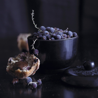 A piece of blueberry muffin with chocolate sauce