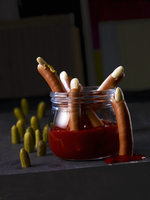 Sausages with almond nails and ketchup blood
