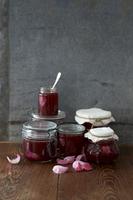 Several preserving jars of rose jam