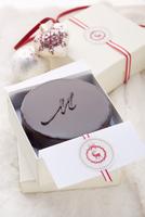 A small Sachertorte (rich chocolate cake from Austria) as a gift