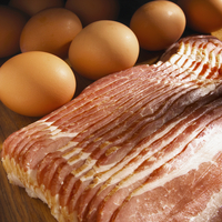 Uncooked Bacon with Brown Eggs