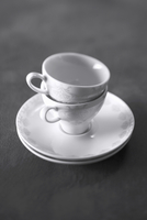 Two coffee cups and saucers