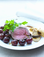 Roast reindeer with cherries and mushrooms