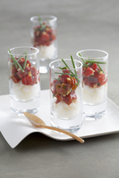 Rice with tomato confit served in glasses as an appetiser