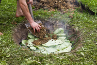 Cooking in a pit in the ground