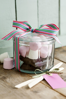 Chunks of chocolate and marshmallows in a jar as a gift