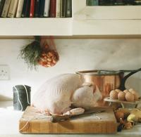 Trussed turkey on chopping board