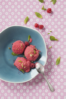 Scoops of Raspberry Ice Cream with Fresh Raspberries and Mint Leaves