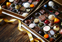 Assorted filled chocolates in chocolate boxes