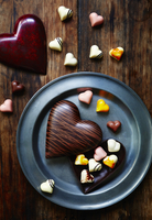Heart-shaped chocolates with a heart-shaped chocolate box