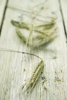 Ears of barley on a wooden surface
