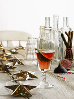 Fig Cocktail with Christmas Decorations & empty bottles