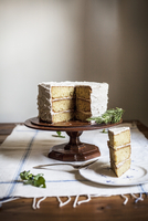 Rosemary Corn Cake with Brown Butter and Honey Buttercream Frosting with a Slice Plated 22199078618| 写真素材・ストックフォト・画像・イラスト素材|アマナイメージズ