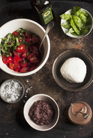 Ingredients for tomato salad with mozzarella and tapenade