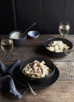 Wide pasta ribbons with bacon and creamy cauliflower sauce