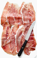 Several slices of Prosciutto from Sardinia, and a knife 22199078859| 写真素材・ストックフォト・画像・イラスト素材|アマナイメージズ