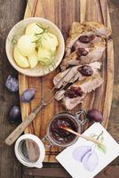 Roast pork, cut into slices, with plum chutney and boiled potatoes 22199078875| 写真素材・ストックフォト・画像・イラスト素材|アマナイメージズ