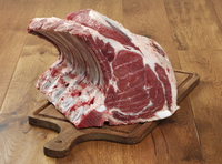 Rack of beef ribs on a chopping board