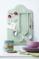 Enamel wall holder with magnets and kitchen utensils