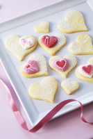 Heart-shaped butter biscuits decorated with sugar hearts