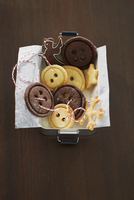 Button biscuits in a tin