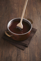 Chocolate in a pan with a wooden spoon
