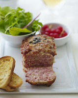 Duck terrine with salad and redcurrants