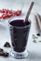Mulled wine in a glass with a cinnamon stick